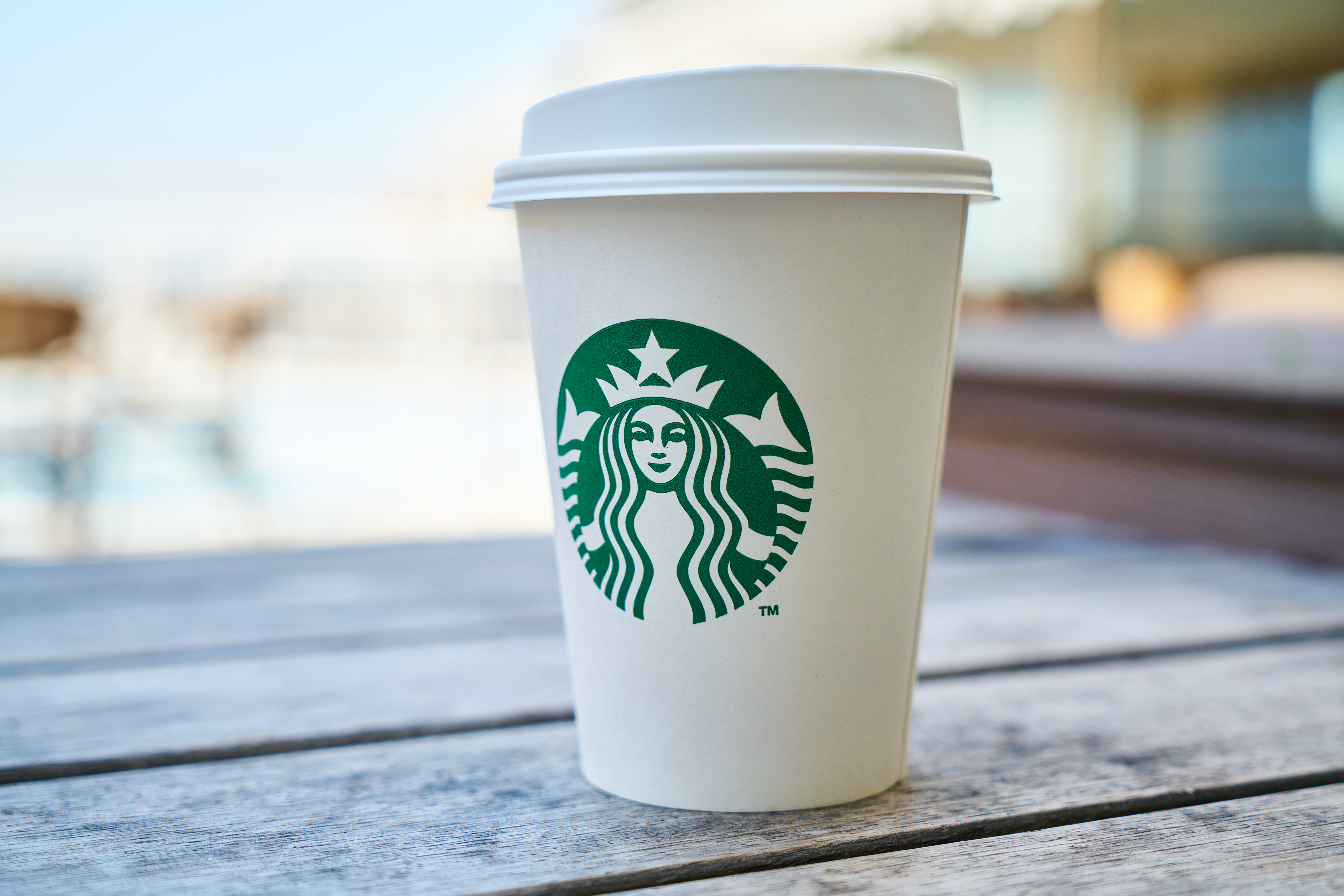closed-white-and-green-starbucks-disposable-cup-efundamentals-blog